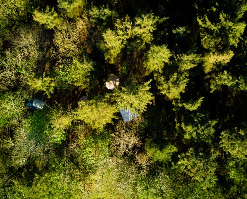 arial-view-green-woodlands-camping-bell-tent