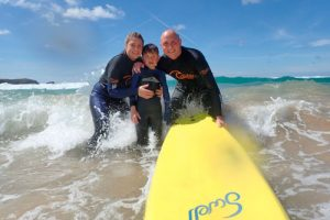 family-posting-surfing-newquay