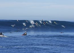 big-ocean-wave-surfers-paddling-to-take-off