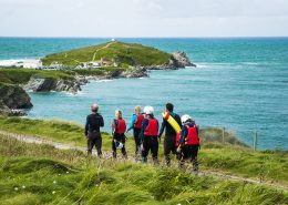 group-walking-to-start-coasteering-session