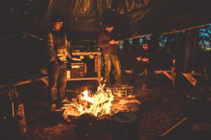 Wild Camping People Standing Round Fire