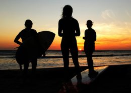 3-surfers-sunset
