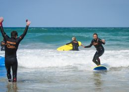 surf-coach-excited-pupil-standing