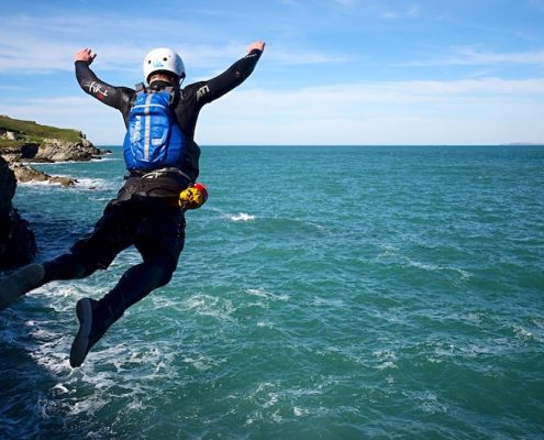 coasteering-guide-jump-mid-air