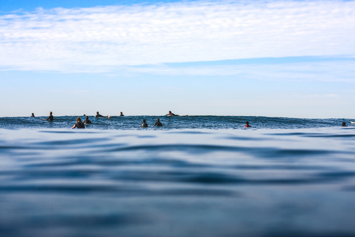 surfers-sitting-in-line-up-water-angle