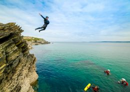 coasteering-guide-mid-air-jump
