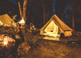 bell-tents-woodland-candles-night