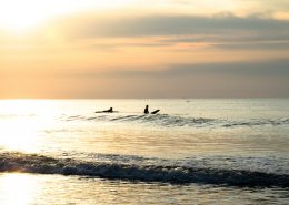 two-surfers-golden-sunset